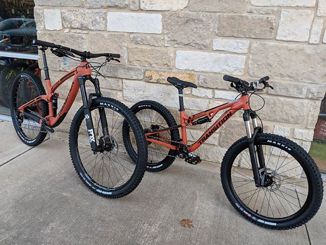 "Are you looking for the perfect parent/child bike combo? Look no further, because @transitionbikes has got you covered! This 2019 carbon Smuggler is in stock alongside a 24"" full squish Ripcord! Both in outlaw orange 🤠 Swipe to see how happy this father and son are on their new bikes!#bike #transitionbikes #christmas #gift #holiday #peddlerbikeshop"